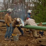 Crews from weld a pipeline connecting to a natural gas well in the Loyalsock State Forest.