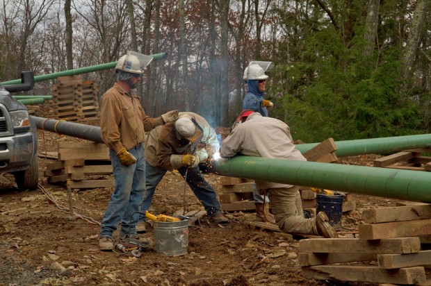 Pipeline workers weld a pipeline connecting to a natural gas well in the Loyalsock State Forest. A new report says the pipeline welds on the proposed Mariner East 2 line exceed federal safety standards.