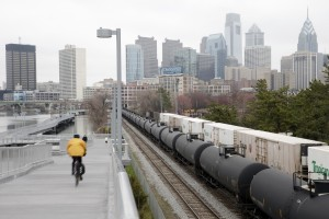 Observers say a proposed PES joint venture is designed to ensure crude supplies for oil trains like this in central Philadelphia