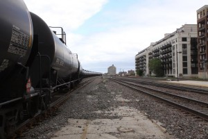 An oil train moves through the University Village neighborhood of Chicago. The trains pass through Chicago on their way to East Coast refineries.