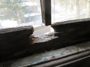A hole in a window frame at the 195-year-old Durham Gristmill.
