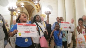 """Education advocates shouted """"tax the shale!"""" during a pro-gas rally."""