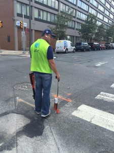 A worker marks utility lines as part of the PA One Call program in downtown Philadelphia. In rural areas, companies that operate natural gas gathering lines are not required to participate in the program.