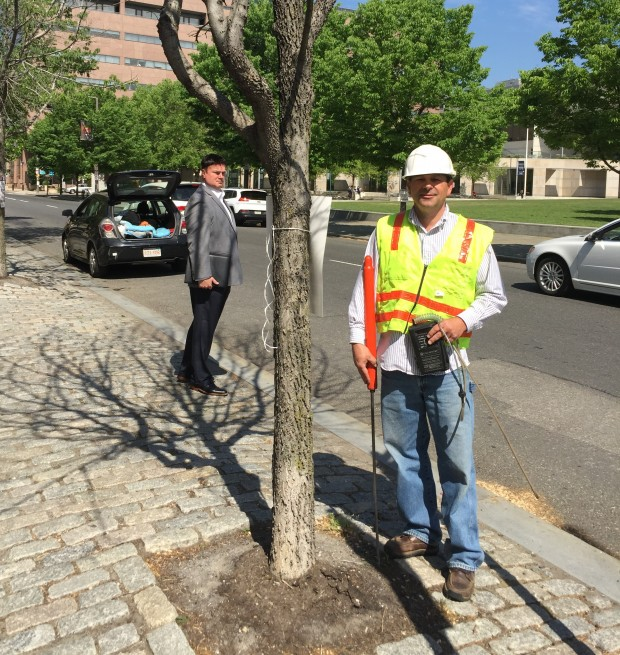 Gas safety consultant Bob Ackley stands next to a dead tree across from the Constitution Center in Philadelphia.