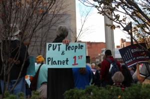 Members of the public gather at a climate rally outside EPA hearings in Pittsburgh, November 12, 2015. The EPA is currently taking public comment on the Clean Power Plan, which aims to cut emissions from coal-fired power plants and provides incentives for renewable energy.