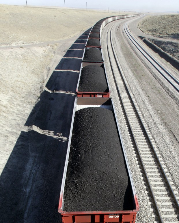 A train loaded with coal from the Powder River Basin travels through northeast Wyoming. Most of the federal coal leases are in Wyoming's Power River Basin.
