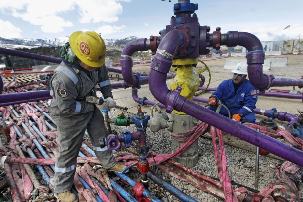 In this March 29, 2013, file photo, workers tend to a well head during a hydraulic fracturing operation outside Rifle, in western Colorado. Two new rules intended to ease tensions over fracking in Colorado will have limited impact, affecting only about 1 percent of the drilling in the state, according to an analysis by state regulators. The Colorado Oil and Gas Conservation Commission is to hold hearings starting Monday, Nov. 16, 2015, on proposals designed to address complaints that arise as Colorado's growing suburbs and oilfields collide.