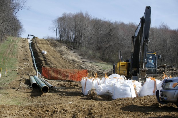 In this April 17, 2014 photo, workers continue the construction at a gas pipeline site in Harmony, Pa. Dennis Martire, from the Laborers' International Union, or LIUNA, said that the man-hours of union work on large pipeline jobs in Pennsylvania and West Virginia have increased by more than 14 times since 2008. (AP Photo/Keith Srakocic)