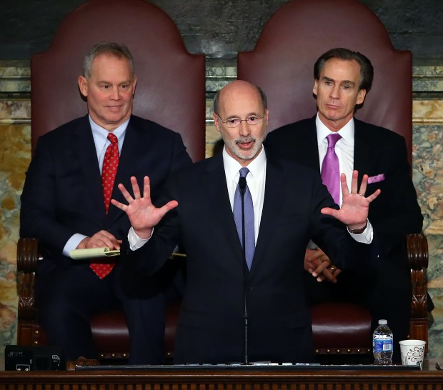 Gov. Tom Wolf, center, delivers his budget address for the 2016-17 fiscal year to a joint session of the Pennsylvania House and Senate, as the speaker of the state House of Representatives, state Rep. Mike Turzai, R-Allegheny, left, and Lt. Gov. Mike Stack, right, listen at the State Capitol in Harrisburg Pa., Tuesday Feb. 9, 2016.