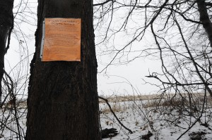 A notice for a Feb. 29 public hearing on a well pad proposed by Apex Energy hangs along Dutch Hollow Road in Penn Township. The proposed pad is one of seven the gas company wants to build in Penn Township.