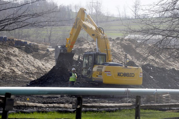 In this April 17, 2014 photo, workers continue the construction at a gas pipeline site in Harmony, Pa.