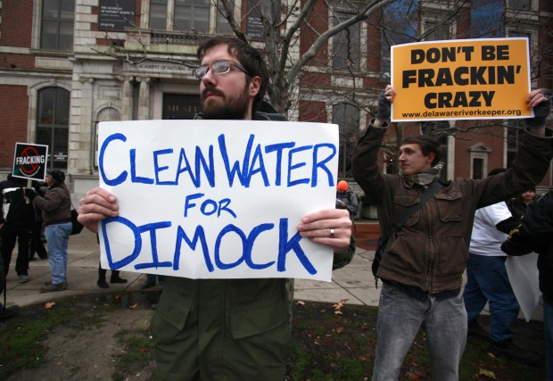 Protestors called for clean water for Dimock in a Philadelphia demonstration in 2012. Two families that sued Cabot Oil & Gas have settled.