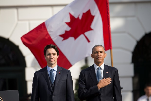 President Barack Obama and Canadian Prime Minister Justin Trudeau, stand for the playing of national anthems during an arrival ceremony on the South Lawn of the White House in Washington, Thursday, March 10, 2016.