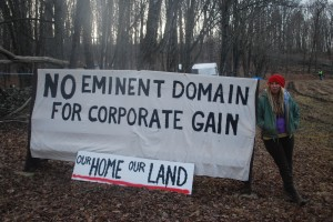 .Megan Holleran stands by a sign on her family's land. The Hollerans lost their court battle to save their maple trees from eminent domain seizure. The trees are being cut to make way for the new Constitution Pipeline.