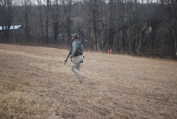 An armed U.S. marshall on his way to accompany two tree cutters at the Holleran property on Tuesday, March 1 2016.