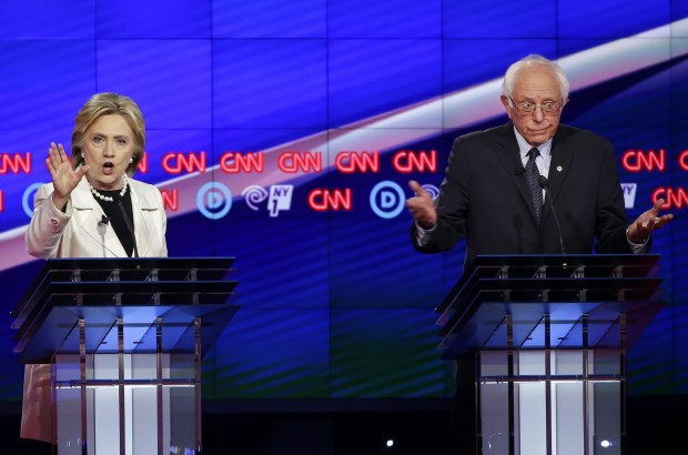 Democratic presidential candidates Sen. Bernie Sanders, I-V.t, right, and Hillary Clinton react as they speak during the CNN Democratic Presidential Primary Debate at the Brooklyn Navy Yard Thursday, April 14, 2016, New York.