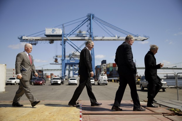 From left,  Holt Logistics President Leo Holt, U.S. Sen. Bob Casey, D-Pa., Philadelphia Regional Port Authority (PRPA) Executive Director James McDermott, Jr. and Chairman of PRPA walk off a platform at the end of a news confrere to call for calling for federal officials to provide funding for a Delaware River dredging project, Friday, April 24, 2015, in Philadelphia. A Casey spokesman said the second-term Democrat plans to send an email to supporters on Friday announcing his support for Hillary Rodham Clinton for president.