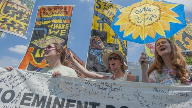 Opponents of the Algonquin Pipeline cheer speakers at a rally after the clean energy march in Philadelphia Sunday afternoon.