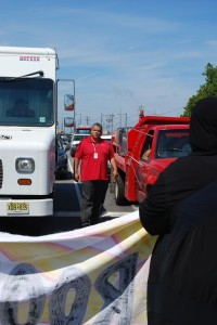 An angry driver approached demonstrators blocking the street outside Philadelphia Energy Solutions South Philadelphia refinery.