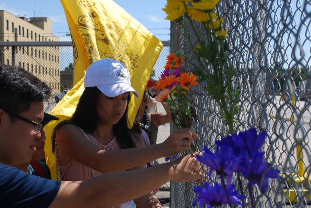 Environmentalists and community activists fixed flowers to the perimeter fence at Philadelphia Energy Solutions during a demonstration calling on the refiner to rethink its plans to expand at the proposed Southport marine terminal.