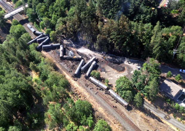 This aerial view provided by the Washington state Department of Ecology scattered and burned oil tank cars shows Saturday, June 4, 2016, after the train derailed and burned near Mosier, Ore., Friday. Union Pacific Railroad says it had recently inspected the section of track near Mosier, about 70 miles east of Portland, and had been inspected at least six times since March 21.