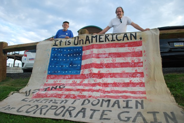Roy Christman (left) and William Kellner outside a FERC meeting on the proposed PennEast pipeline where they displayed a banner objecting to the possible use of eminent domain by pipeline companies to enable construction on private land.