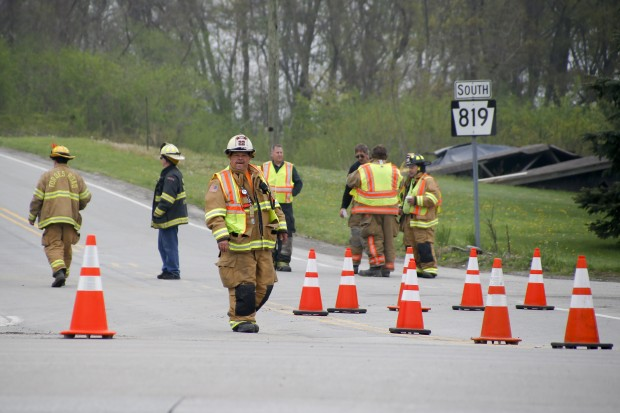 First responders block the access to the area where a natural gas explosion at a pipeline burned one person and damaged houses on Friday, April 29, 2016, in Salem Township, Pa. The explosion caused flames to shoot above nearby treetops in the largely rural area, about 30 miles east of Pittsburgh, and prompted authorities to evacuate businesses nearby.