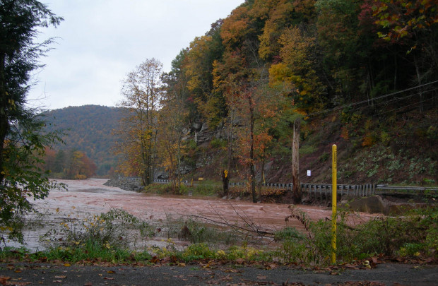 Heavy rains brought flash floods to Lycoming County, which washed out a bridge  on Wallis Run Road. The yellow pipeline marker shows the location of the Sunoco pipeline that ruptured and spilled an estimated 55,000 gallons of gasoline into Wallis Run creek.