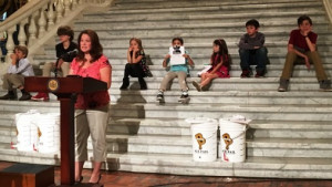 Children sat on the steps of the Capitol rotunda as their parents talked about the effects of methane on their communities.