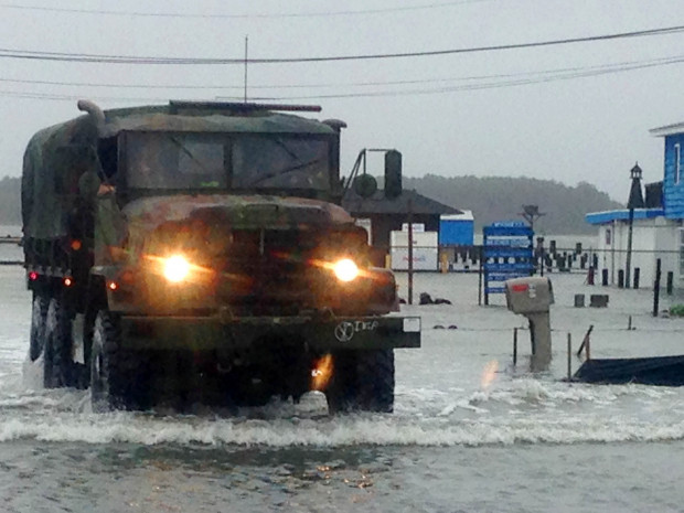Police patrol flooded streets in a military vehicle in Dewey Beach, Del., on Saturday, Oct. 3, 2015. Tidal flooding from a nor'easter continues to make driving a challenge in the storm-battered resort town of Ocean City, Maryland.