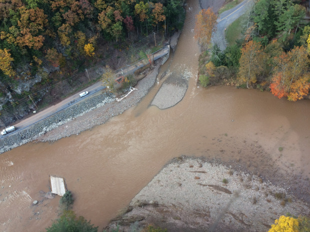 An aerial photo shows flood water damage of the roadway and the Wallis Run Bridge in Gamble, Pa. Sunoco officials say the bridge washed downstream and struck the pipeline, spilling an estimated 55,000 gallons of gasoline.