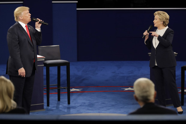 Republican presidential nominee Donald Trump and Democratic presidential nominee Hillary Clinton exchange views during the second presidential debate at Washington University in St. Louis, Sunday, Oct. 9, 2016.