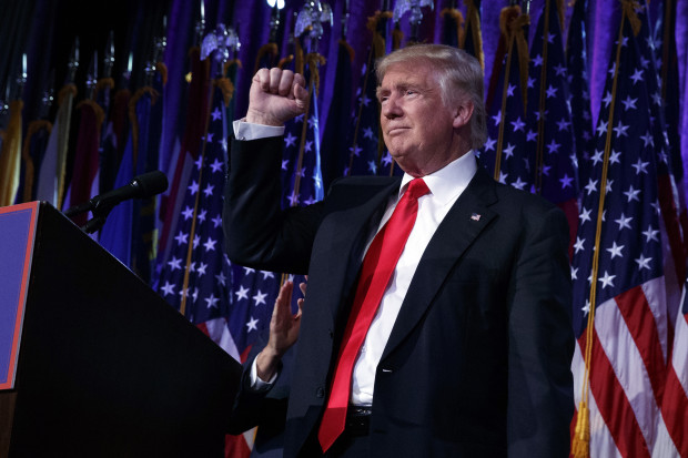 President-elect Donald Trump pumps his fist during an election night rally Wednesday in New York.