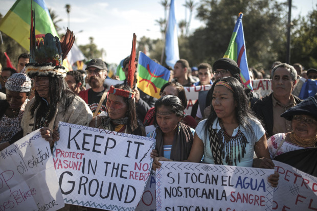 Hundreds protest against climate change and urge world leaders to take actions, in a march coinciding with the Climate Conference, known as COP22, taking place in Marrakech, Morocco, Sunday, Nov. 13, 2016.