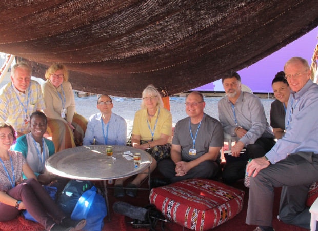 Diane Husic (C), with Franco Montalto (second from right) sit with a group of students and professors from Pennsylvania universities under a tent at the climate conference in Marrakech, Morocco, Nov. 17, 2016.