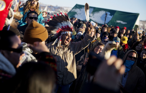 A crowd gathers in celebration at the Oceti Sakowin camp after it was announced that the U.S. Army Corps of Engineers won't grant easement for the Dakota Access oil pipeline in Cannon Ball, N.D., Sunday, Dec. 4, 2016.