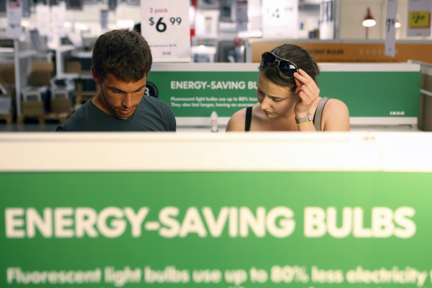 Philadelphia has launched a program to improve the energy efficiency of low-income residences, as well as small businesses in the city. In this file photo, Joe Mozloom and Allison Roethke shop for compact fluorescent bulbs at an Ikea store in Philadelphia, June 15, 2010.