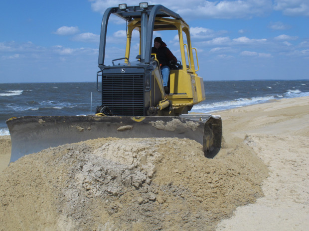 A front-end loader moves sand on Delaware Bay Beach in Middle Township, NJ that was badly eroded by Superstorm Sandy. Scientists working on water quality issues in the Delaware Estuary say actions by the Trump administration over the last several days have them worried.