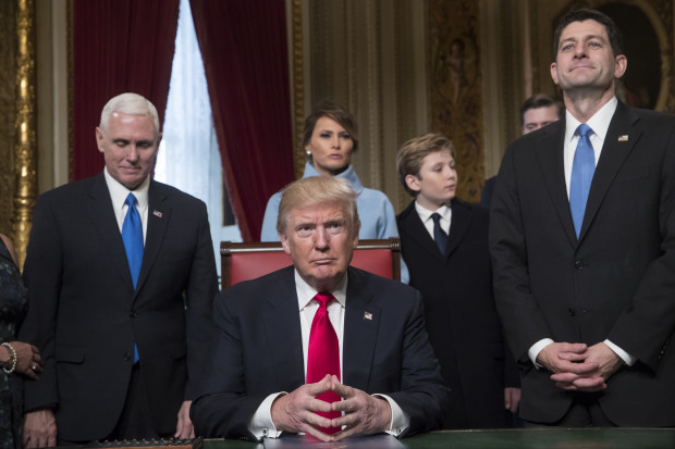 President Donald Trump is joined by the Congressional leadership and his family before formally signing his cabinet nominations into law, in the President's Room of the Senate, at the Capitol in Washington, Friday, Jan. 20, 2017. From left are Vice President Mike Pence, the president's wife Melania Trump, their son Barron Trump, and Speaker of the House Paul Ryan, R-Wis.
