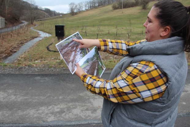 Veronica Coptis shows pictures of the reconstruction of Polen Run, a Greene County stream undermined by Consol Energy.