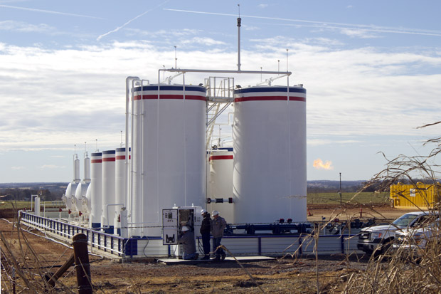 FILE: Oil-field workers tend to American Energy-Woodford's Judge South well in November 2014 well shortly after the Oklahoma Corporation Commission ordered it temporarily shut-in.