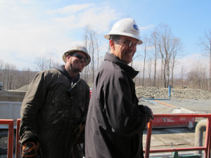 Cabot Oil and Gas spokesman George Stark with a gas worker on a drill rig in Susquehanna County. Cabot issued a statement applauding the judge's decision.