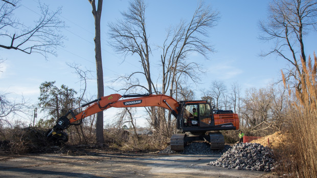 A worker clears trees for the Mariner East 2 pipeline in Aston, Delaware County.