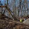 A backhoe clears land for construction of the Mariner East 2 pipeline in Delaware County in early 2017.
