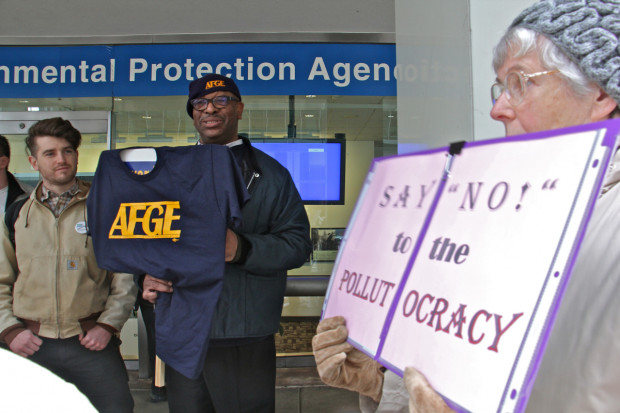 Gary Morton, president of the American Federation of Government Employees Local which represents EPA workers, joins protesters outside the agency's Center City offices.