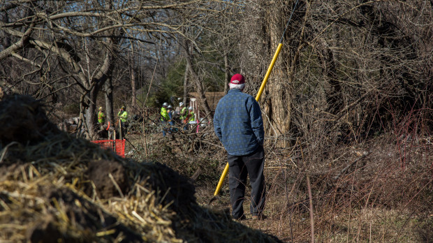 A resident of Aston, Delaware County, looks on as workers begin building the Mariner East 2 pipeline in Delaware County.