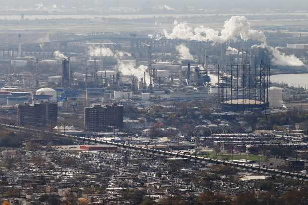 A refinery, homes and tank cars is seen Tuesday, Nov. 24, 2015, in Philadelphia.