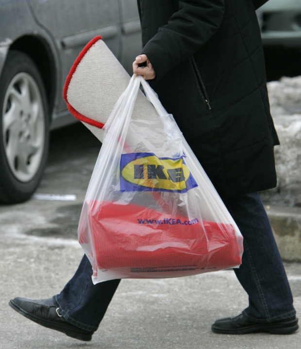 A customer totes a shopping bag outside an Ikea store in Conshohocken, Pa., on Tuesday, Feb. 20, 2007. The Swedish retailer, which has its U.S. headquarters in suburban Conshohocken, announced Tuesday that it will start charging customers a nickel for
