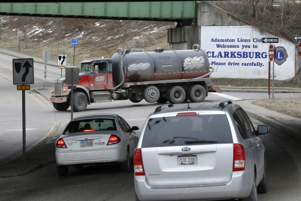 A truck carrying fracking waste water drives through an intersection in Clarksburg, W. Va.