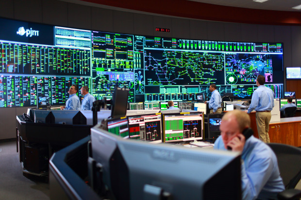 "A view of the PJM Interconnection control room. PJM is the largest grid operator in North America. A report out by Moody's this week says a glut of natural gas will ""wreak havoc"" on the region's electricity market."